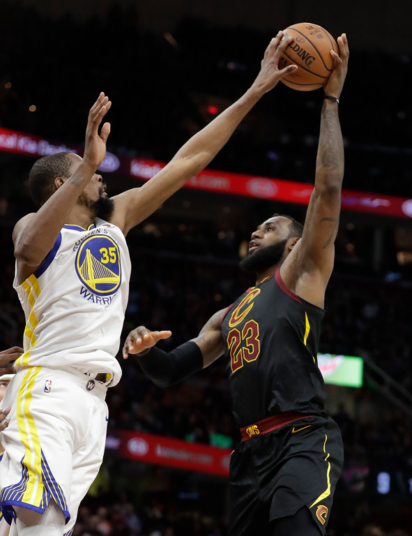 . Cleveland Cavaliers\' LeBron James has his shot blocked by Golden State Warriors\' Kevin Durant during the second half of Game 3 of basketball\'s NBA Finals, Wednesday, June 6, 2018, in Cleveland. (AP Photo/Tony Dejak)