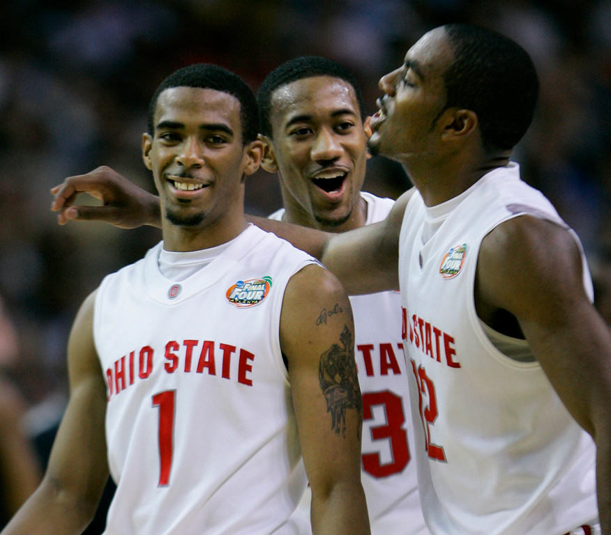 . Ohio State guard Mike Conley Jr. (1), David Lighty (23), center and Ron Lewis (12)celebrate in closing seconds during their men\'s semifinal basketball game at the Final Four in the Georgia Dome in Atlanta Saturday, March 31, 2007. Ohio State defeated Georgetown 67-60 to advance to the championship game.(AP Photo/Gerry Broome)