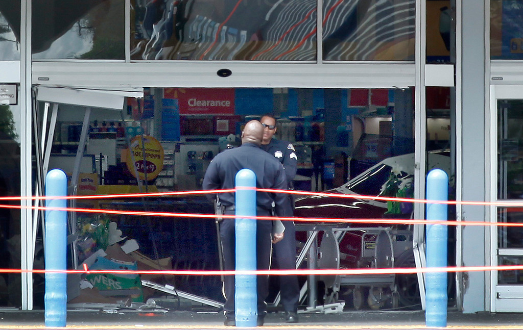 . Police investigate an incident at the Walmart on Story Road in San Jose, Calif., where a vehicle drove into the building and a driver reportedly began assaulting people in the store on Sunday, March 31, 2013. (Karl Mondon/Staff)