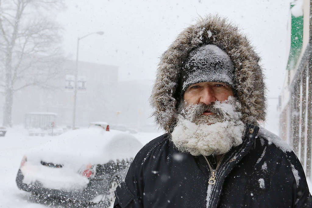 . David Murphy made his way down West Street to try and get to Domino\'s Pizza during the storm on Thursday February 9, 2017. His beard was covered in snow it so bad out. SENTINEL & ENTERPRISE/JOHN LOVE