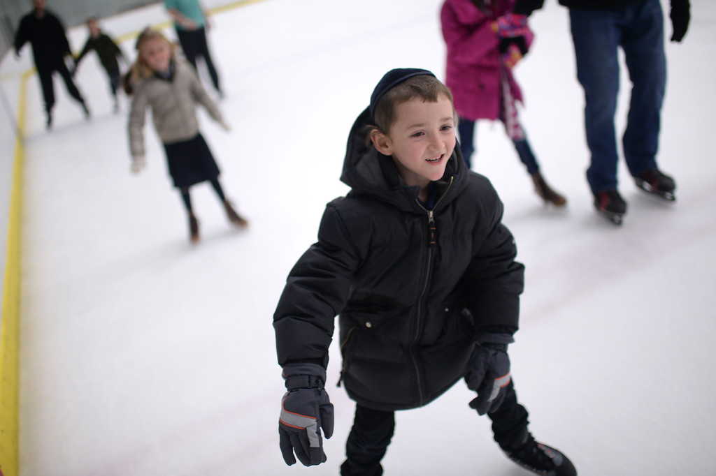 . CENTENNIAL, CO. DECEMBER 25: Dovid Siedenfeld is ice skating to Shia Drexler, 3, at the the South Suburban Sports Center in Centennial, Colorado on December 25, 2013. For the fourteenth year, the Denver Community Kollel Women\'s Division is offering a Jewish Family Extravaganza of family fun and entertainment.  (Photo by Hyoung Chang/The Denver Post)