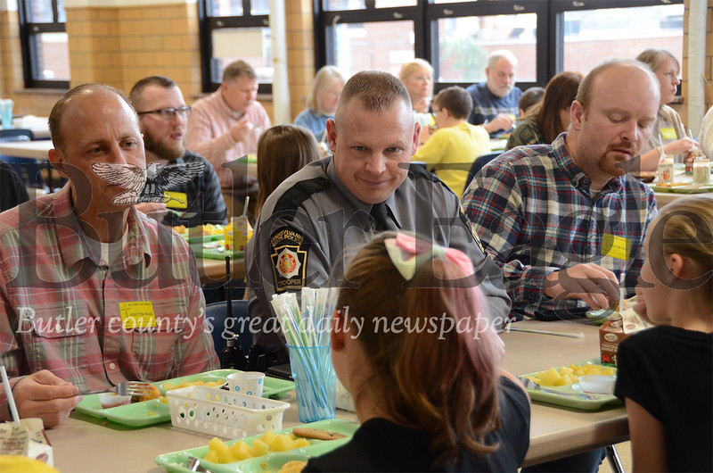 Trooper Herbert Rieger enjoying lunch with 3rd grade parents and students.  (If you need the parent names, Dave Dalcamo is on the left in the pic, and Kris Simmons is on the right) at Butler Catholic School. Butler Catholic School had over a dozen state troopers for lunch Jan. 29 during Catholic Schools Week. submitted photo
