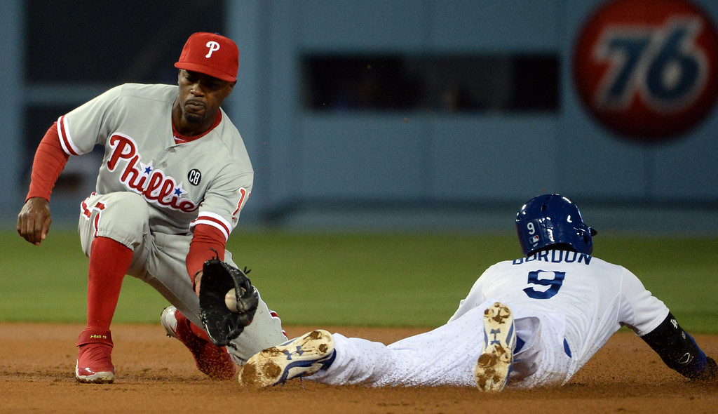 . Los Angeles Dodgers\' Dee Gordon (9) steals second base as Philadelphia Phillies shortstop Jimmy Rollins waits for the baseball in the second inning of a baseball game on Tuesday, April 22, 2013 in Los Angeles.   (Keith Birmingham/Pasadena Star-News)