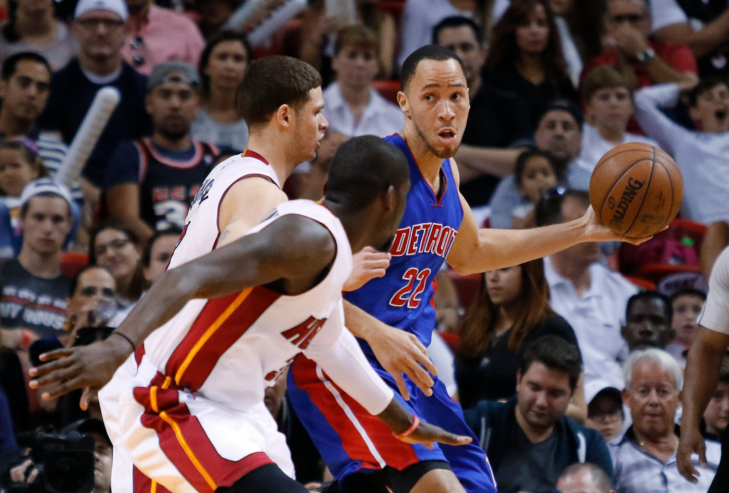 . Detroit Pistons forward Tayshaun Prince (22) looks to pass under pressure from Miami Heat\'s Tyler Johnson, left, and James Ennis during the first half of an NBA basketball game, Sunday, March 29, 2015, in Miami. (AP Photo/Joe Skipper)