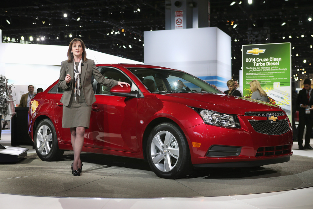 Description of . Cristi Landy, small car marketing director for Chevrolet, introduces the 2014 Cruze with a 2.0 turbo diesel motor at the Chicago Auto Show on February 7, 2013 in Chicago, Illinois. The Chicago Auto Show, one of the oldest and largest in the country, will be open to the public February 9-18.  (Photo by Scott Olson/Getty Images)