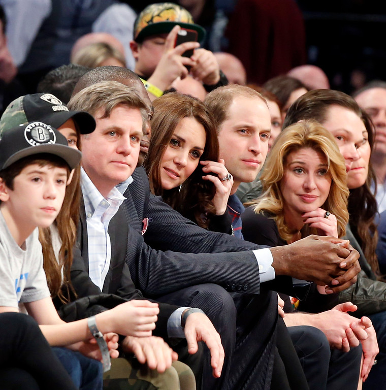 . Kate, the Duchess of Cambridge, and Britain\'s Prince William, center, watch from court side during an NBA basketball game between the Cleveland Cavaliers and the Brooklyn Nets at the Barclays Center in New York, Monday, Dec. 8, 2014. (AP Photo/Kathy Willens)