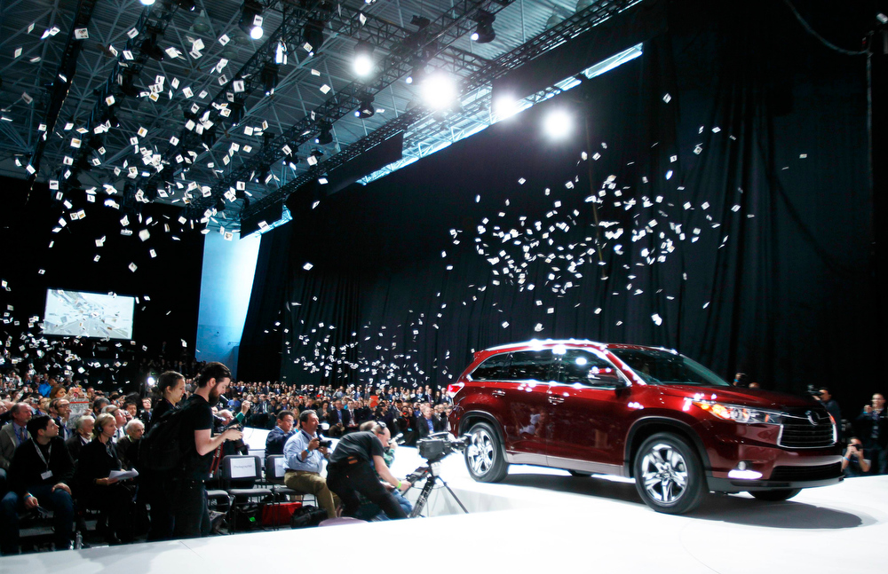 Description of . The new Toyota Highlander is unveiled during a news conference at the New York Auto Show at the Javits Center in New York, March 27, 2013.   REUTERS/Carlo Allegri