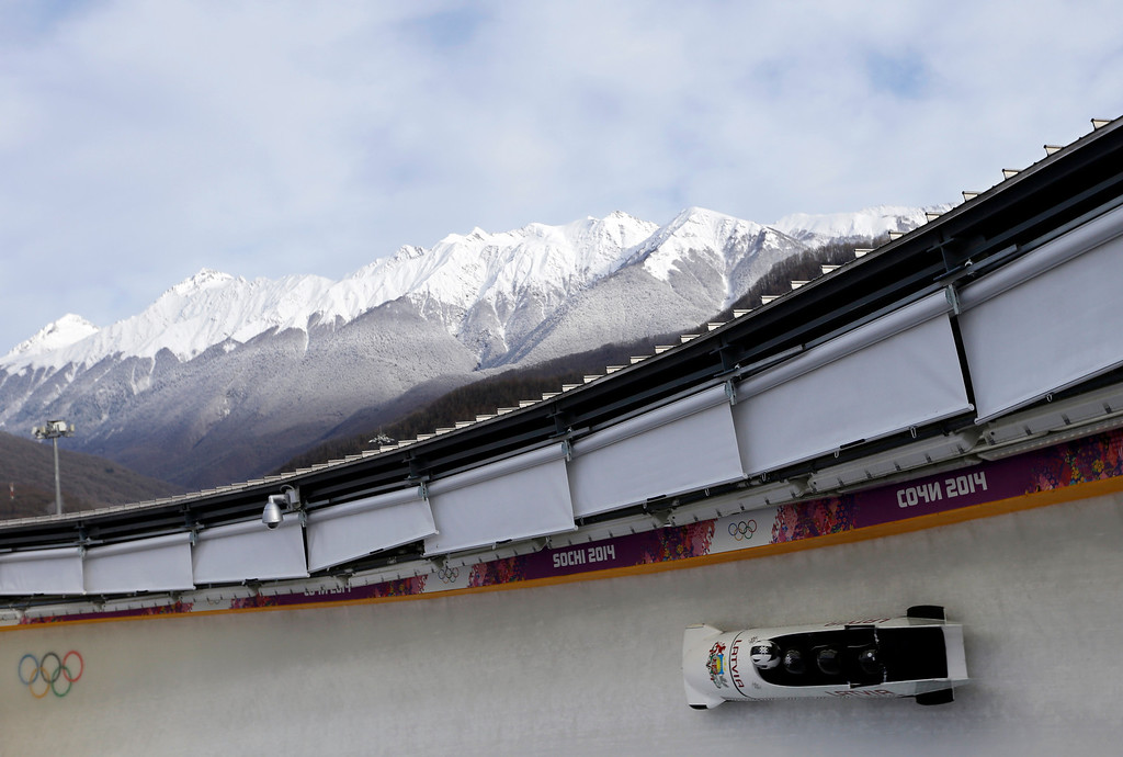 . The team from Latvia LAT-1, piloted by Oskars Melbardis, take a curve during the men\'s four-man bobsled training at the 2014 Winter Olympics, Wednesday, Feb. 19, 2014, in Krasnaya Polyana, Russia. (AP Photo/Natacha Pisarenko)