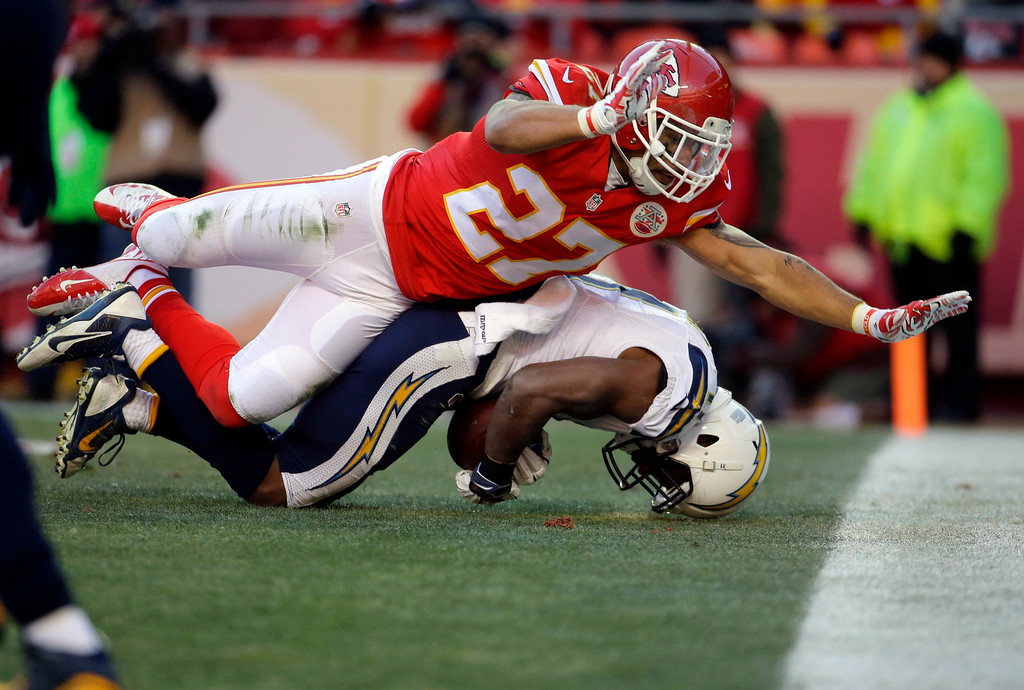. San Diego Chargers wide receiver Eddie Royal (11) can\'t control a touchdown pass against the defense of Kansas City Chiefs defensive back Kurt Coleman (27) during the second half of an NFL football game in Kansas City, Mo., Sunday, Dec. 28, 2014. (AP Photo/Charlie Riedel)