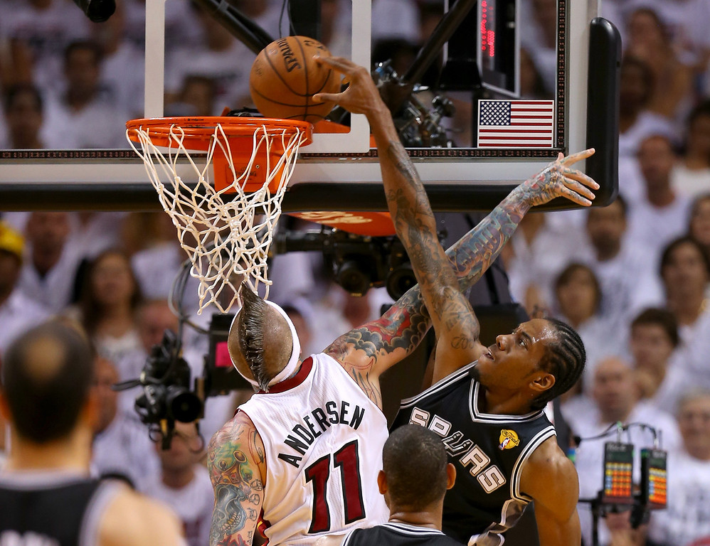 . Kawhi Leonard #2 of the San Antonio Spurs goes up for a dunk over Chris Andersen #11 of the Miami Heat in the second quarter during Game Seven of the 2013 NBA Finals at AmericanAirlines Arena on June 20, 2013 in Miami, Florida.   (Photo by Mike Ehrmann/Getty Images)