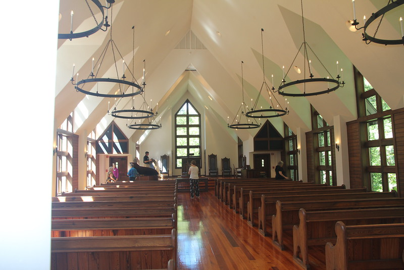 high ceilings and tall windows bring natural light inside Chatlos Chapel at The Cove
