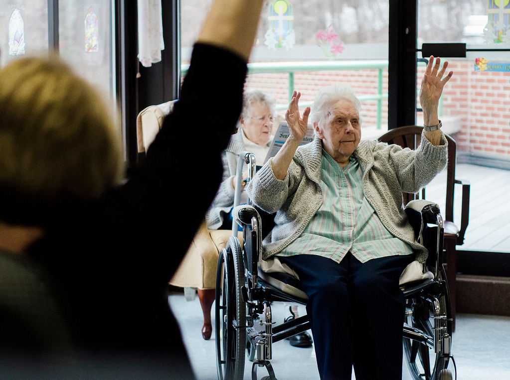 """. Sister Anna Farragher takes part in a \""""Sit and Fit\"""" class at Sisters of the Presentation, a retirement home for nuns in Leominster on Wednesday, April 5, 2017. SENTINEL & ENTERPRISE / Ashley Green"""