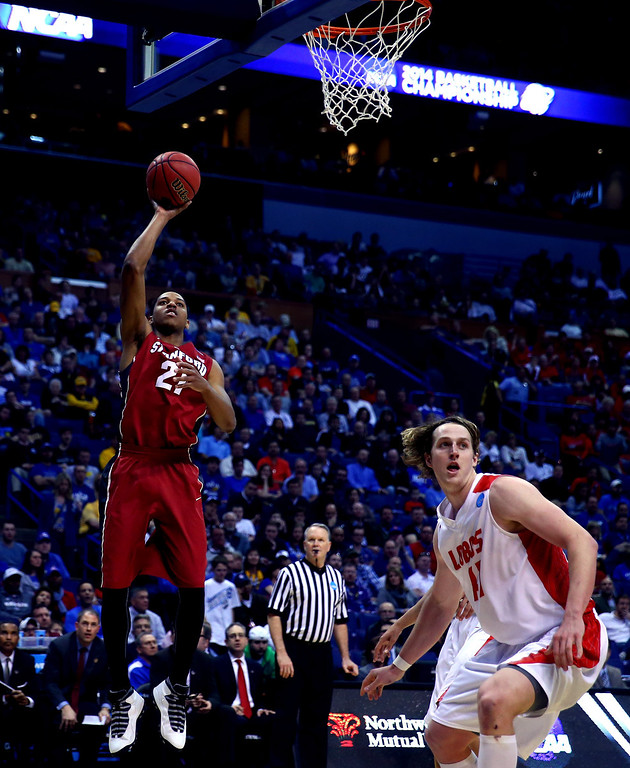 . Anthony Brown #21 of the Stanford Cardinal shoots the ball against Cameron Bairstow #41 of the New Mexico Lobos during the second round of the 2014 NCAA Men\'s Basketball Tournament at Scottrade Center on March 21, 2014 in St Louis, Missouri.  (Photo by Dilip Vishwanat/Getty Images)