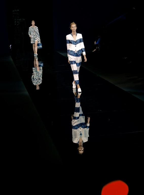 . Models wear creations for Emporio Armani women\'s Spring Summer 2015 collection, part of the Milan Fashion Week, unveiled in Milan, Italy, Thursday, Sept. 18, 2014. (AP Photo/Antonio Calanni)