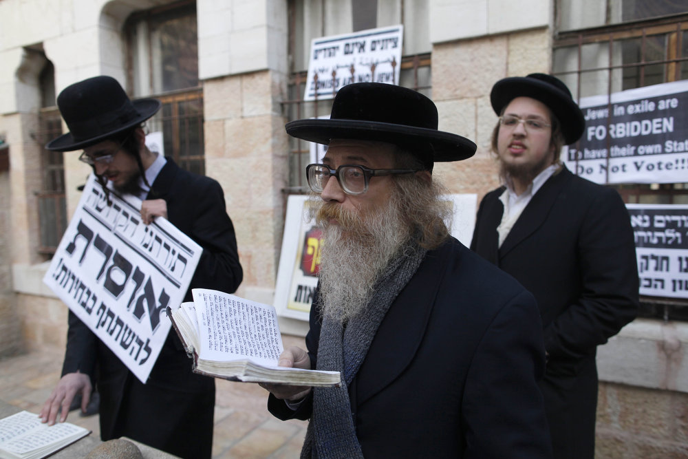 Description of . Members of Neturei Karta, a fringe ultra-Orthodox movement within the anti-Zionist bloc, take part in a protest against Israel's parliamentary election in Jerusalem's Mea Shearim neighbourhood on January 22, 2013 in Jerusalem, Israel. Israel's general election voting has begun today as polls show Netanyahu is expected to return to office with a narrow majority. (Photo by Lior Mizrahi/Getty Images)