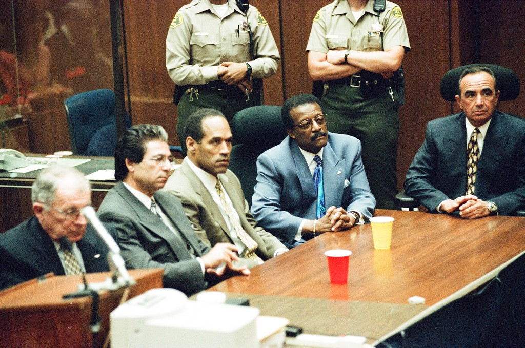 . This Oct. 3, 1995 file photo shows O.J. Simpson with defense attorneys. Simpson was found not guilty of murdering his ex-wife Nicole Brown Simpson and her friend Ron Goldman at the Criminal Courts Building in Los Angeles. (Los Angeles Daily News file photo)
