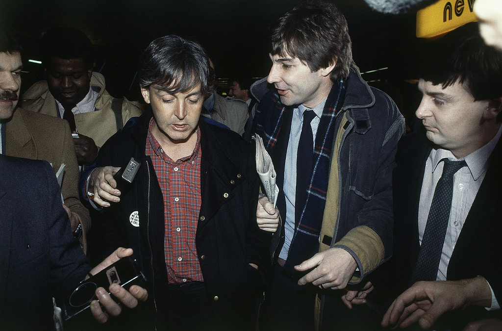 . Paul McCartney talking to newsmen in London on Jan. 24, 1984 after his wife was arrested and charged with possessing marijuana. (AP Photo)