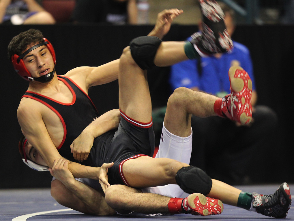 . James Logan\'s Artemio Flores, top, wrestles, Bella Vista\'s Victor Trujillo in a 126-pound fifth place match during the California Interscholastic Federation wrestling championships in Bakersfield, Calif., on Saturday, March 2, 2013. Trujillo would go onto win the match. (Anda Chu/Staff)