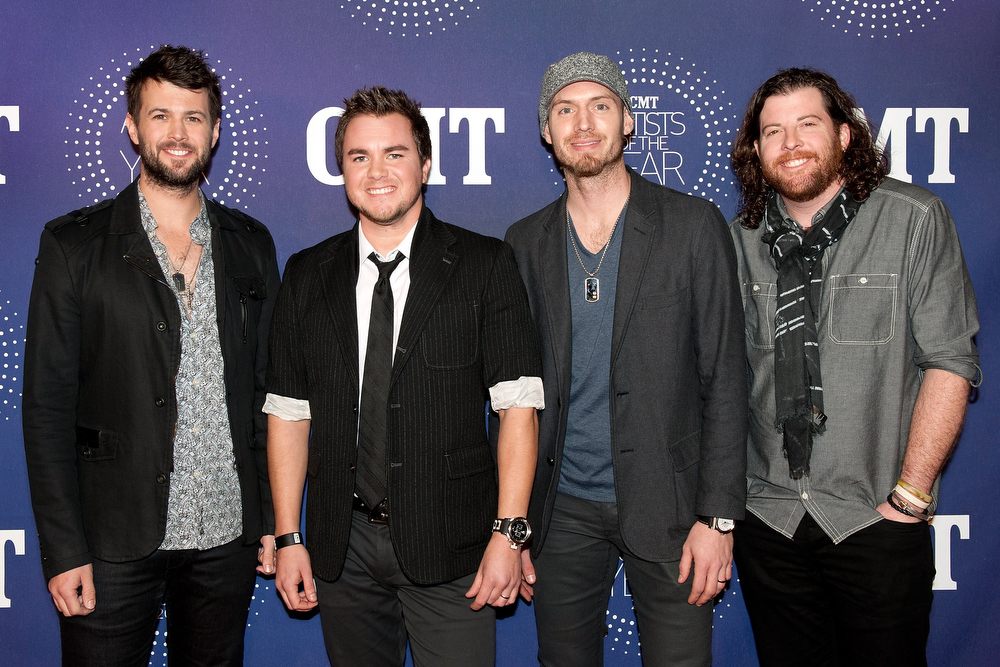 ". Jon Jones, Mike Eli, James Young, and Chris Thompson of Eli Young Band attend the 2012 CMT ""Artists Of The Year\"" Awards at The Factory At Franklin on December 3, 2012 in Franklin, Tennessee.  (Photo by Erika Goldring/Getty Images)"
