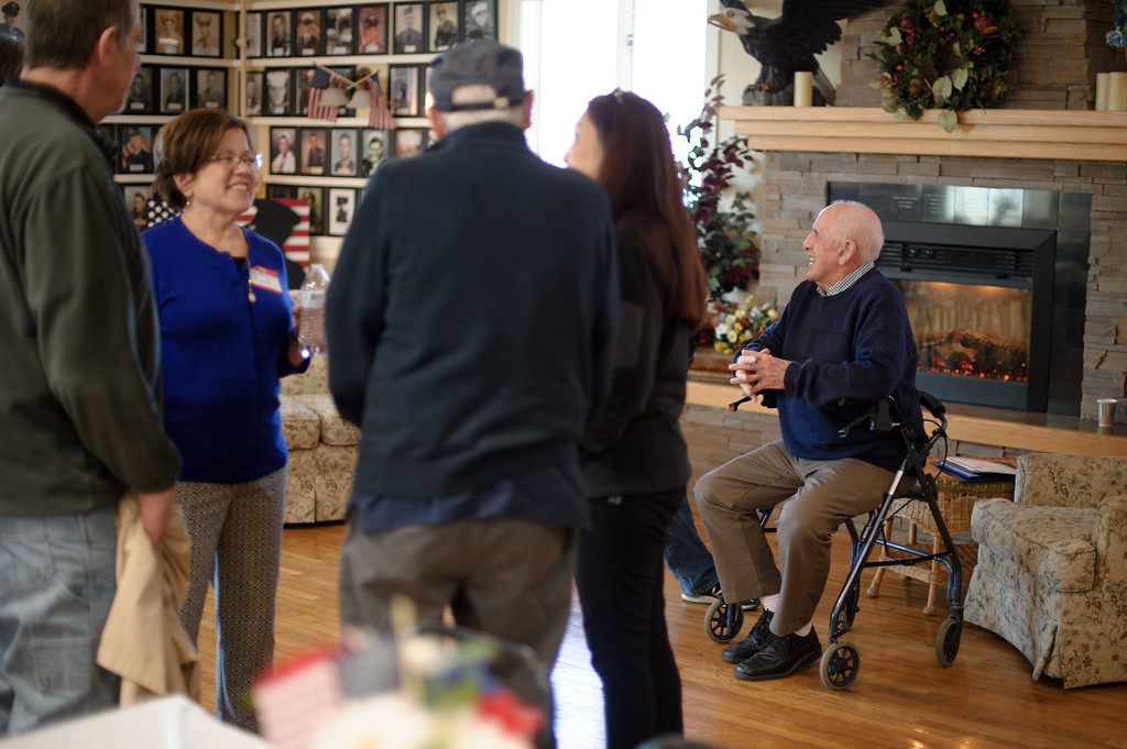 . Malcom Brown (right) sit\'s on his walker as guest\'s wish him a happy 100th birthday at the Veterans Memorial Center in Leominster on Sunday April 9, 2017.  (Sentinel & Enterprise photo/Jeff Porter)