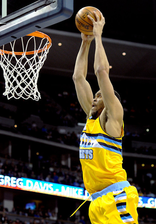 . Denver center Javale McGee dunked the ball in the first quarter. The Denver Nuggets hosted the Charlotte Bobcats at the Pepsi Center Saturday night, December 22, 2012.  Karl Gehring/The Denver Post