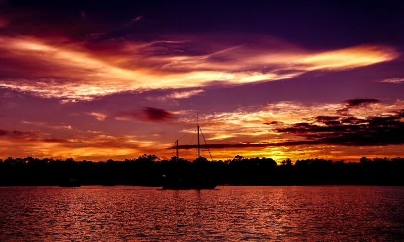 Vibrant colored cloudy sunset seascape. Coastal Australia.