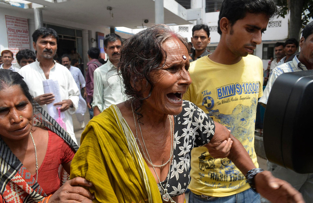 . A woman cries after her grandson, who consumed spurious meals at a school on Tuesday, died at a hospital in the eastern Indian city of Patna July 17, 2013. At least 20 children died and dozens were taken to hospital with apparent food poisoning after eating a meal provided for free at their school in the district of Chapra in the eastern Indian state of Bihar, the education minister said on Wednesday, sparking violent protests.  REUTERS/Stringer
