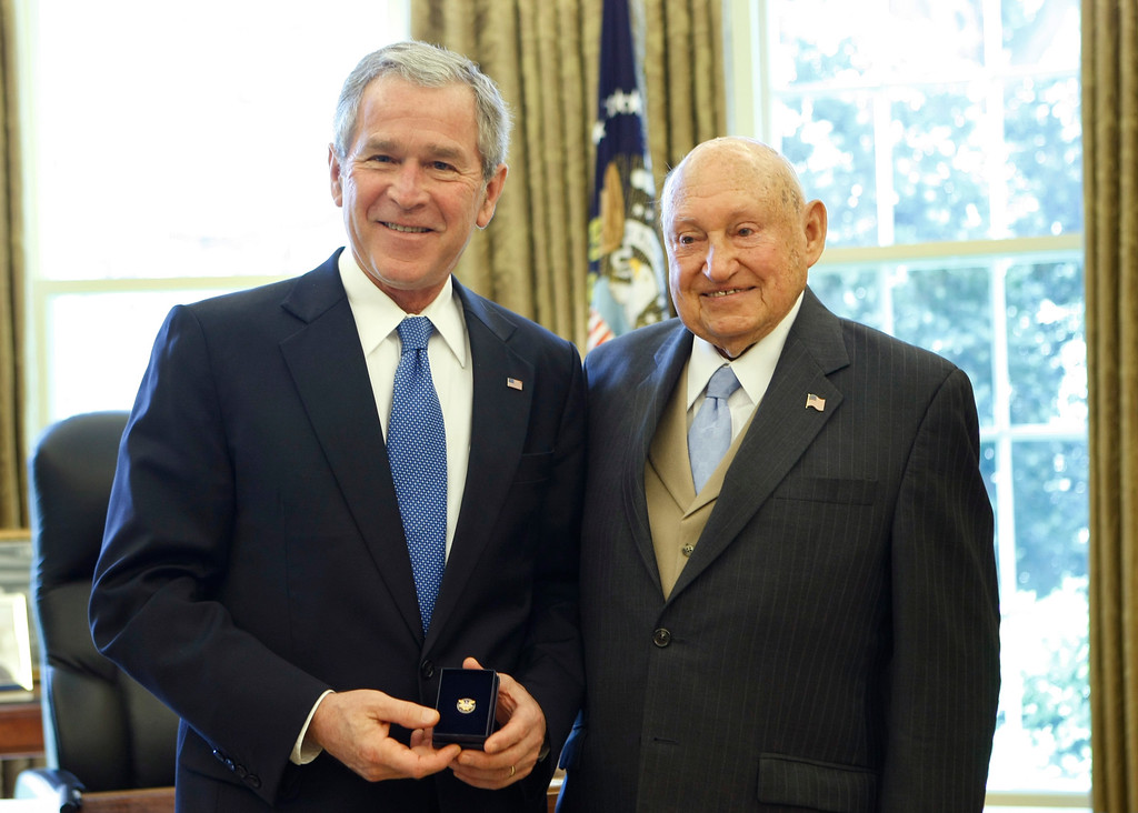 . President Bush presents the Lifetime President\'s Volunteer Service Award to Chick fil-A Inc. founder Truett Cathy, Tuesday, April 15, 2008, in the Oval Office of the White House in Washington.  (AP Photo/Gerald Herbert)