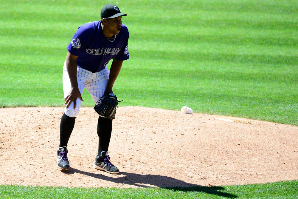 . Colorado Rockies starting pitcher Juan Nicasio (44) reacts to a ball four call on a pitch to San Diego Padres right fielder Kyle Blanks (88) during the action in Denver. The Colorado Rockies hosted the San Diego Padres at Coors Field on Sunday, June 9, 2013. (Photo by AAron Ontiveroz/The Denver Post)