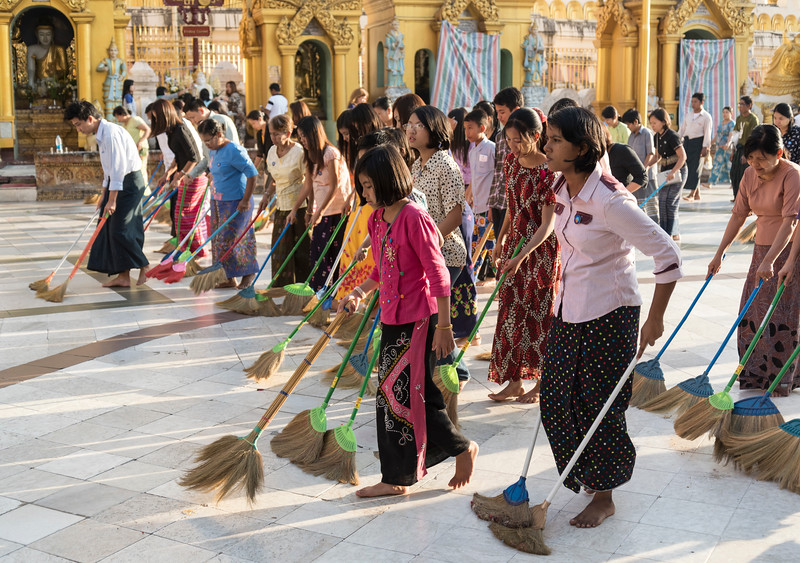 Burmese women sweep the floor of Shwedagon Pagoda, Yangon (Rangoon), Myanmar (Burma)