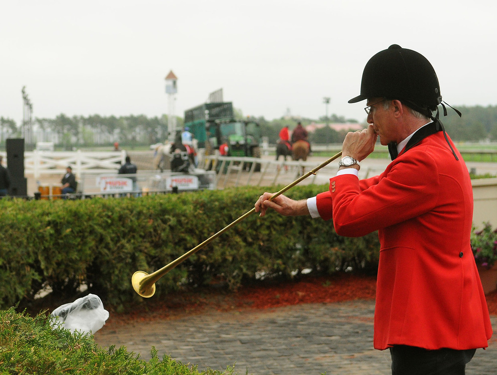 . The track bugler announces the horses for the first race of the 2013 racing season. (Pioneer Press: John Autey)