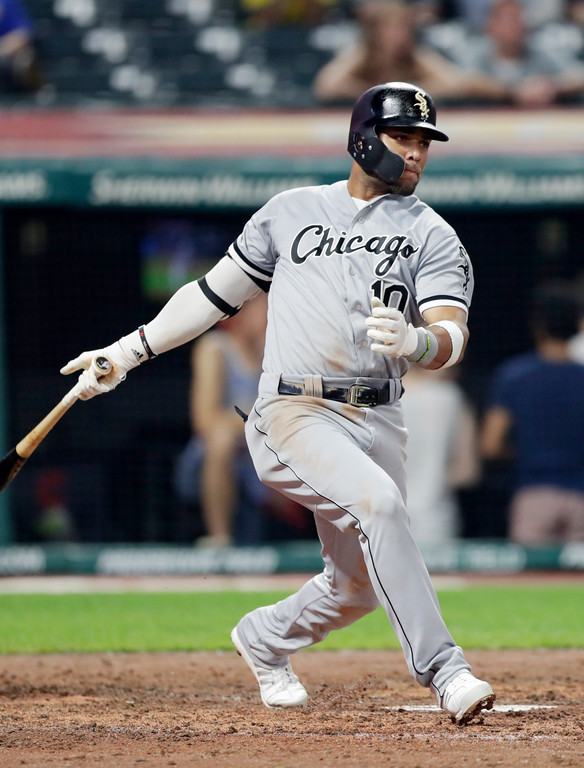 . Chicago White Sox\'s Yoan Moncada hits a single in the eighth inning of a baseball game against the Cleveland Indians, Monday, June 18, 2018, in Cleveland. (AP Photo/Tony Dejak)