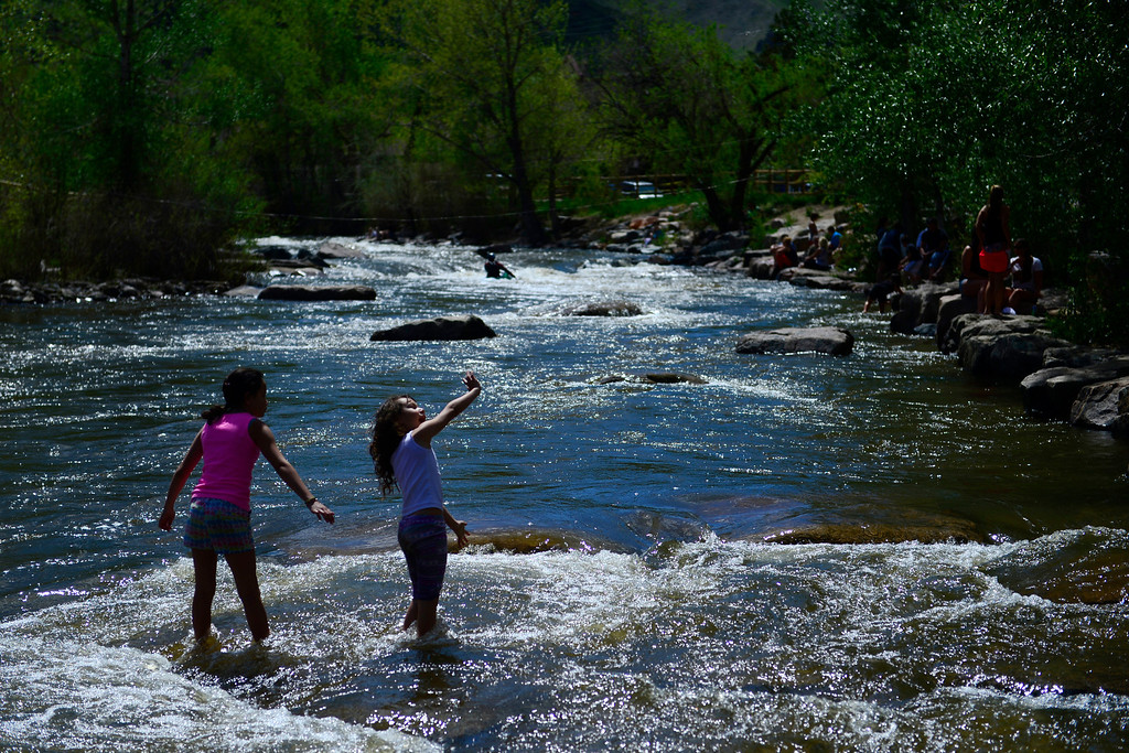 . Trinity Dietz, 12, and her sister, Bethany, 8, walk into the water during Golden Games at the Clear Creek Whitewater Park. (Photo by AAron Ontiveroz/The Denver Post)
