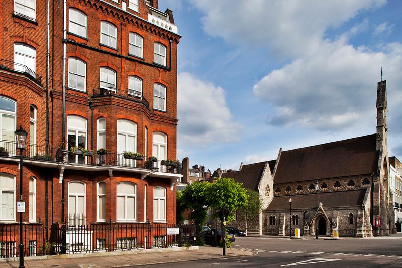 Red brick Victorian house and church on Lennox Gardens, Kensington, London, England, United Kingdom