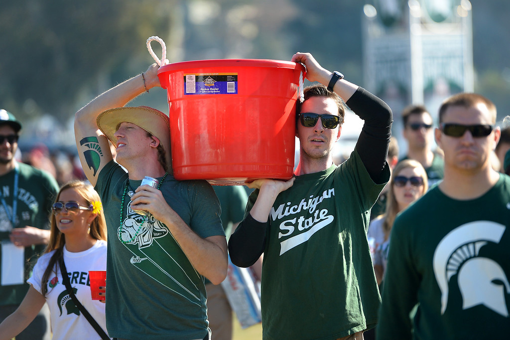 . Michigan State fans carry a bucket of refreshments in front of the Rose Bowl before the game, Wednesday, January 1, 2014. (Photo by Michael Owen Baker/L.A. Daily News)