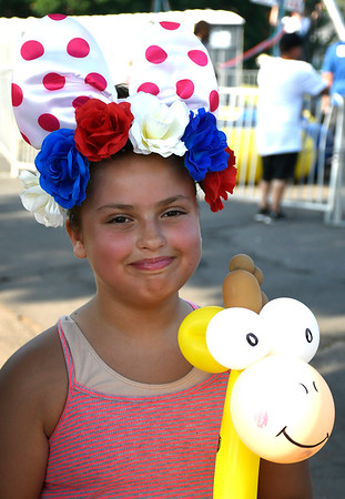 7/4/2018 Mike Orazzi | Staff Olivia Marquez,10, while in New Britain's Stanley Quarter Park for 4th of July events Wednesday.