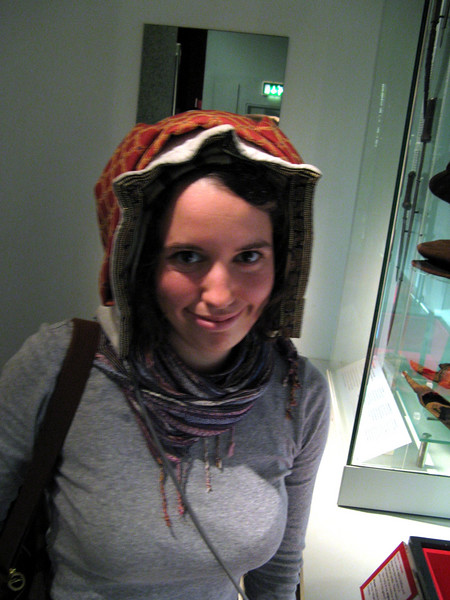 We went to the Museum of London, which had some costume fragments.  Stephanie models this bonnet from some century or another.