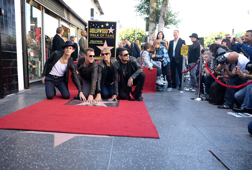 . From left: Perry Farrell, Stephen Perkins, Chris Chaney and Dave Navarro of the alt-rock band Jane\'s Addiction pose at their star at the ceremony honoring the band with a star on The Hollywood Walk of Fame, October 30, 2013 in Hollywood, California.           (ROBYN BECK/AFP/Getty Images)