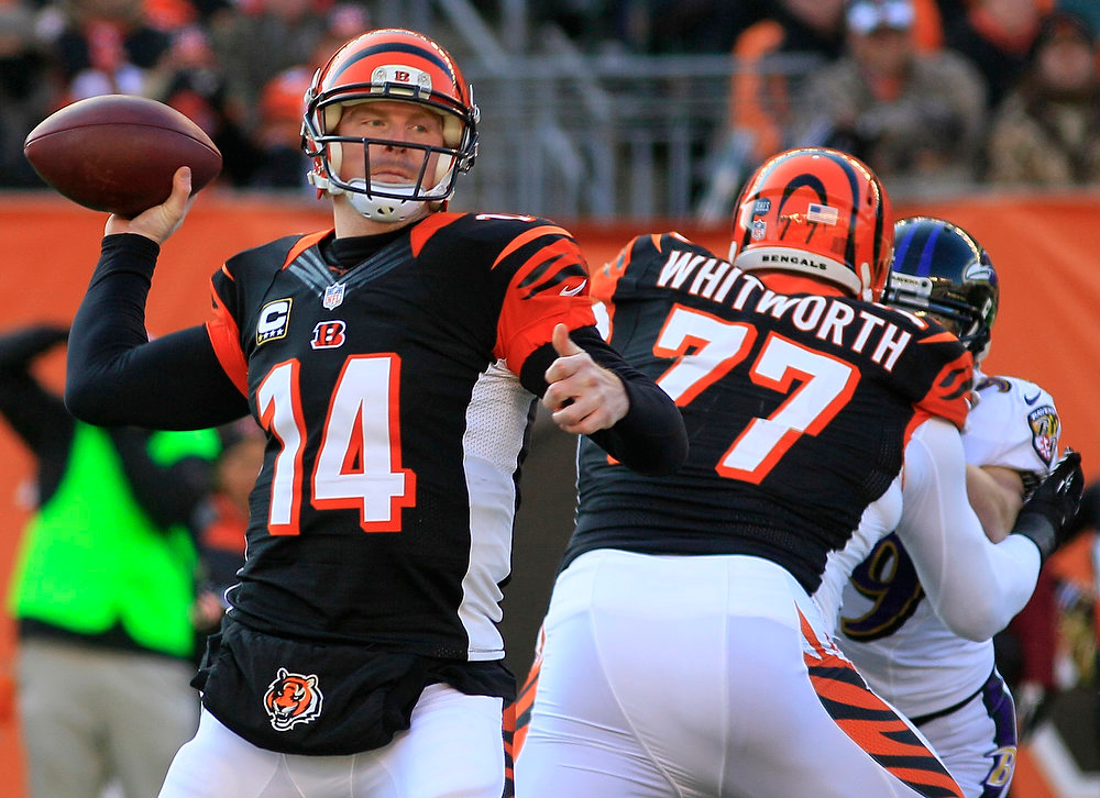 Description of . Cincinnati Bengals quarterback Andy Dalton (14) passes against the Baltimore Ravens in the first half of an NFL football game on Sunday, Dec. 30, 2012, in Cincinnati. (AP Photo/Tom Uhlman)