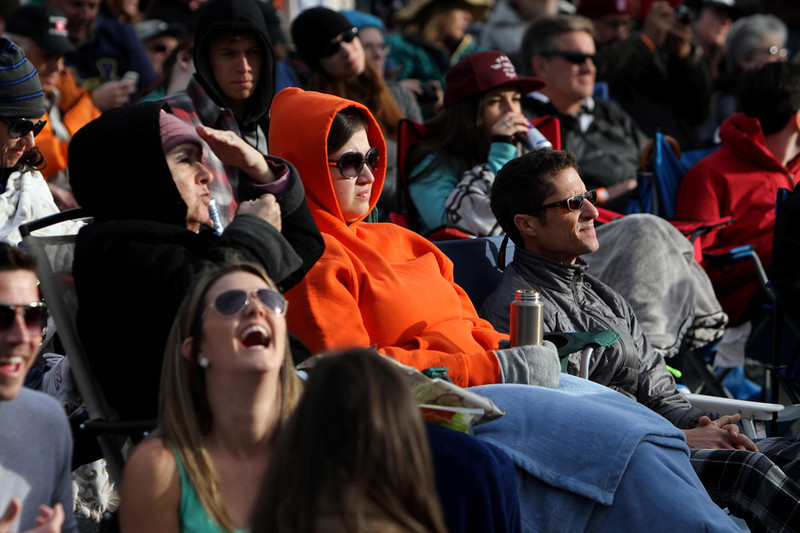 . Thousands of fans sit on lawn chairs and beach blankets as they watch the Mavericks Invitational surfing competition from an oversized screen in Half Moon Bay on Friday morning. (Kevin Johnson/Sentinel)