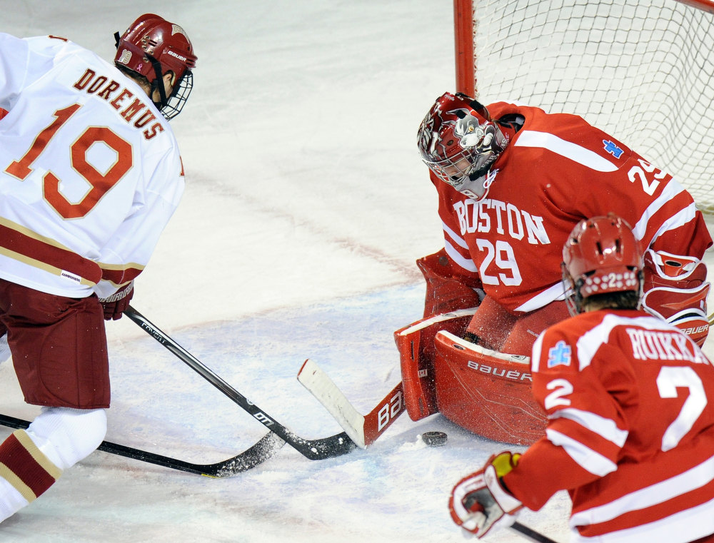 . Boston University goalie Matt O\'Connor (29), right, is defending the goal from University of Denver\'s Daniel Doremus (19) in the 2nd period of the game at Magness Arena in Denver, Colo. on Saturday, December 29, 2012. Hyoung Chang, The Denver Post