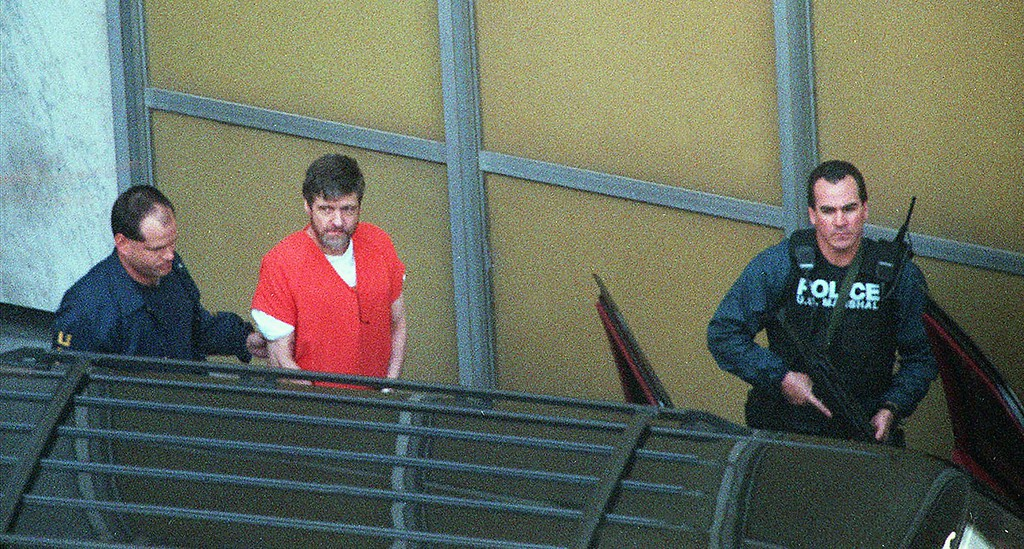 . Theodore Kaczynski is led from the Federal Courthouse in Sacramento, Calif., Thursday, Jan. 22, 1998, after he pleaded guilty to being the Unabomber. Kaczynski will spend the rest of his life in prison without parole. (AP Photo/Bob Galbraith)