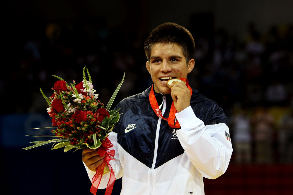 Description of . Henry Cejudo of the United States poses with his medal after defeating Shingo Matsumoto of Japan to win the gold medal in the men's 55kg freestyle wrestling event at the China Agriculture University Gymnasium on Day 11 of the Beijing 2008 Olympic Games on August 19, 2008 in Beijing, China.  (Photo by Jed Jacobsohn/Getty Images)
