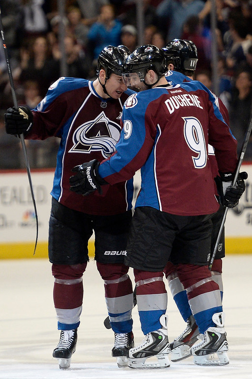 . Matt Duchene (9) of the Colorado Avalanche celebrates his game-winning goal with teammate Cody McLeod (55) of the Colorado Avalanche against the Winnipeg Jets during the Avs\' 3-2 win. (Photo by AAron Ontiveroz/The Denver Post)