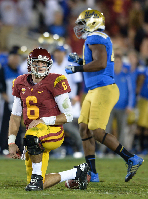 . USC QB Cody Kessler is on a knee after loosing the ball in the 4th quarter. UCLA defeated USC 35 to 14 in a matchup of cross town rivals at the Los Angeles Memorial Coliseum in Los Angeles, CA.  photo by (John McCoy/Los Angeles Daily News)