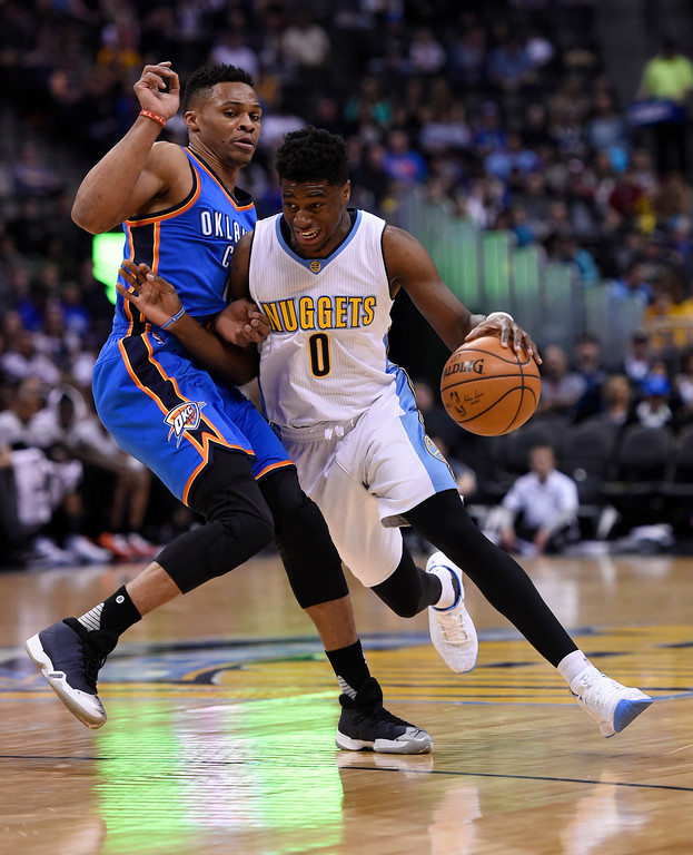 . Denver Nuggets guard Emmanuel Mudiay (0) drives around Oklahoma City Thunder guard Russell Westbrook (0) during the first quarter April 5, 2016 at Pepsi Center. (Photo By John Leyba/The Denver Post)