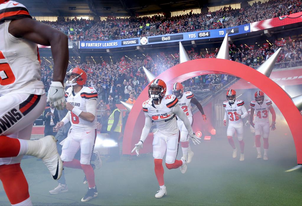 . Cleveland Browns safety Briean Boddy-Calhoun (20), center, runs onto the field with his teammates before an NFL football game against Minnesota Vikings at Twickenham Stadium in London, Sunday Oct. 29, 2017. (AP Photo/Matt Dunham)