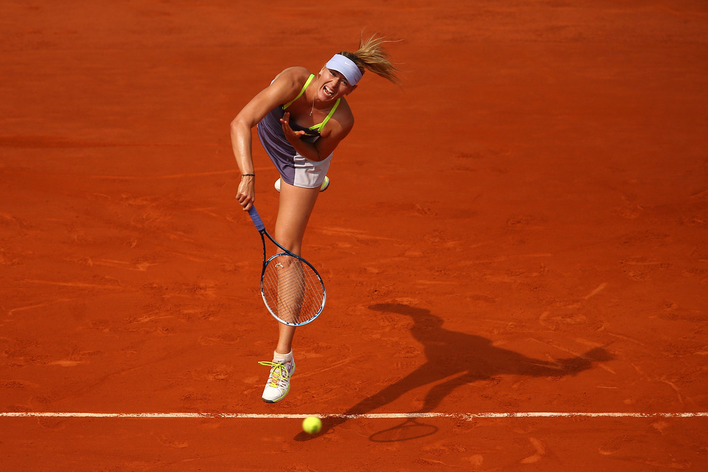 . Maria Sharapova of Russia serves in her Women\'s Singles Final match against Serena Williams of United States of America during day fourteen of French Open at Roland Garros on June 8, 2013 in Paris, France.  (Photo by Julian Finney/Getty Images)