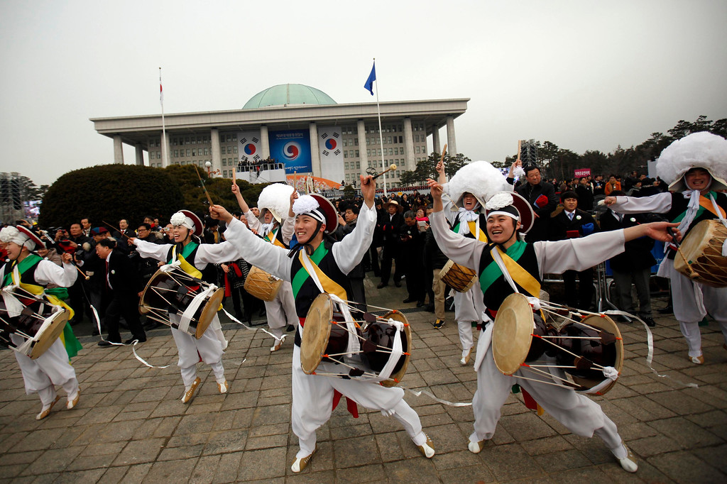 """. Members of a \""""Samulnori\"""" dance troupe, or traditional South Korean percussion assemble, perform during the inauguration of South Korea\'s new President Park Geun-hye (not pictured) at parliament in Seoul February 25, 2013.  REUTERS/Kim Hong-Ji"""