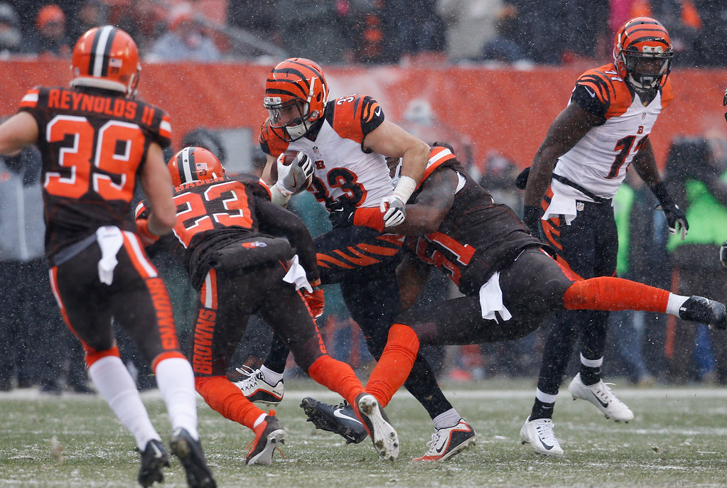 . Cincinnati Bengals running back Rex Burkhead (33) runs the ball in the first half of an NFL football game against the Cleveland Browns, Sunday, Dec. 11, 2016, in Cleveland. (AP Photo/Ron Schwane)